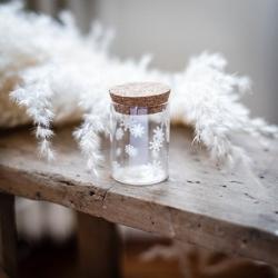 fiole verre flocons blancs bouchon